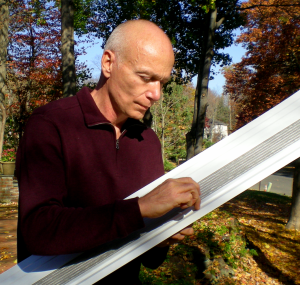 Alex Higginbotham Checking MasterShield Gutter Guard