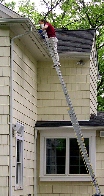 Gutter Cleaning on Two-Story House