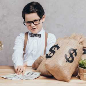 child with a lot of money